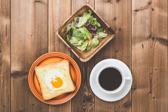 Wood table and breakfast Royalty Free Stock Images