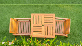 Wood table and chair table on grass Royalty Free Stock Image