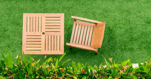 Wood table and chair table on grass Royalty Free Stock Photos
