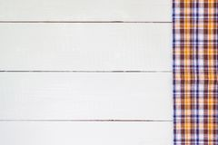 Wood table. Checkered tablecloth on wooden table Royalty Free Stock Photos