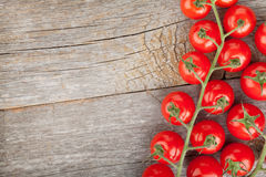 Wood table with cherry tomatoes Stock Photography