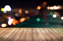 Wood table with city lights night blurred background Stock Photos
