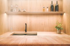 Wood table counter top on blur kitchen interior background Royalty Free Stock Image