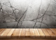 Wood table with cracked stone wall background Royalty Free Stock Photography