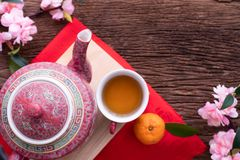 Wood table with cup of tea and Cherry blossom, Chinese new year celebration background stock image