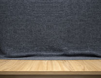 Wood table with dark blue cotton fabric background Stock Photography