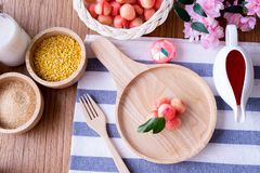 Wood table with Delectable imitation fruits, Fruit Shaped Mung Beans. Thai traditional dessert royalty free stock photos