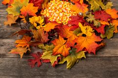 Wood table with fall halloween candy decor royalty free stock photography