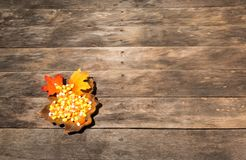 Wood table with fall halloween candy decor Royalty Free Stock Photos