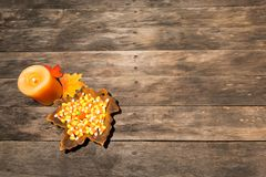 Wood table with fall halloween candy decor stock images