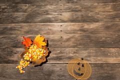 Wood table with fall halloween candy decor stock photography