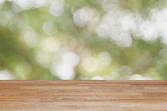 Wood table floor on blur abstract natural green and bokeh backgr Stock Images