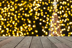 Wood table in front of gold christmas bokeh lights, stock photos
