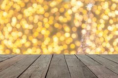 Wood table in front of golden  christmas bokeh lights, Stock Photos
