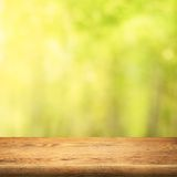 Wood table on green summer forest background royalty free stock photos