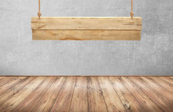 Wood table with hanging wooden sign Stock Images