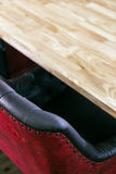 Wood Table with Leather Chair. Royalty Free Stock Photos