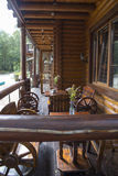 The wood table on natural outdoor of a restaurant with tree Royalty Free Stock Image