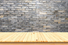 Wood table and brick wall background. stock images