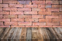 Wood table with red brick wall texture Stock Photography