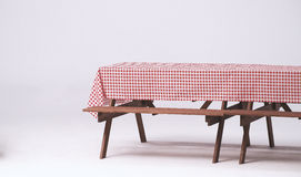 Wood table and red napkin for outdoor party. Stock Photo