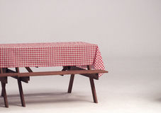 Wood table and red napkin for outdoor party. Royalty Free Stock Photography