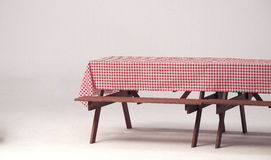 Wood table and red napkin for outdoor party. Royalty Free Stock Images