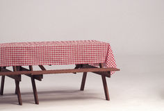 Wood table and red napkin for outdoor party. Stock Photos