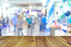 Wood table on Shopping mall blur background with bokeh. Wood table on Shopping mall blur background with bokeh Stock Images