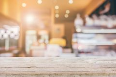 Wood table top with blur Coffee shop background royalty free stock photo