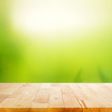 Wood table top on abstract nature green background Royalty Free Stock Photography
