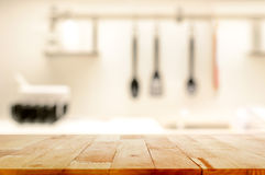 Wood table top (as kitchen island) on blur kitchen background stock image