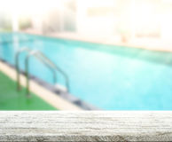 Wood Table Top Background And Pool Royalty Free Stock Images