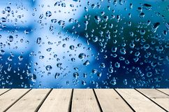 Water drops. Wood table top Background of water drops on glass - Use background for product display montage Stock Images
