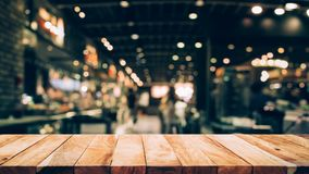 Wood table top Bar with blur light bokeh in dark night cafe,restaurant background Stock Images
