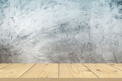 Wood table top on bare concrete wall background Stock Photography