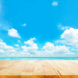 Wood table top on blue sea & sky background Royalty Free Stock Photos