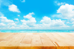 Wood table top on blue sea & sky background Stock Image