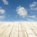 Wood table top on blue sky blurry backgrounds. Royalty Free Stock Photography