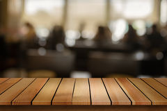 Wood table top on blur bokeh cafe background can be used for dis Stock Photography