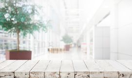 Wood table top on blur building hall background Stock Photography