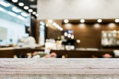 Wood table top on blur cafe restaurant with bokeh background Royalty Free Stock Photos