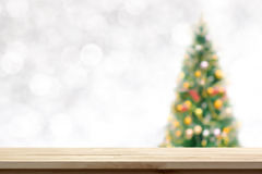 Wood table top on blur Christmas tree background stock photography