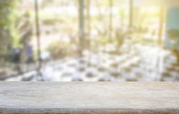 Wood table top on blur coffee shop or kitchen window background Royalty Free Stock Photography