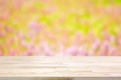 Wood table top on blur flower garden background Stock Photos
