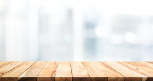 Wood table top on blur glass window wall building background royalty free stock photography