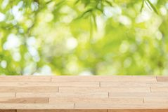 Wood table top on blur green abstract background from nature royalty free stock image