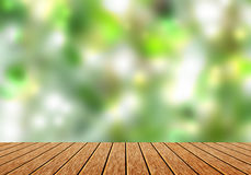 Wood table top with blur green nature bokeh background. Can use for magazine or put any word on it Stock Photo