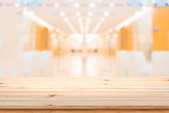 Wood table top on blur interior hotel background. Royalty Free Stock Photo