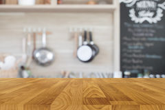 Wood table top with blur kitchen background Stock Photography